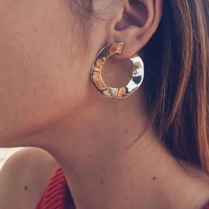 Urban Outfitters Jewelry - Sterling silver hammered disc half hoop earring